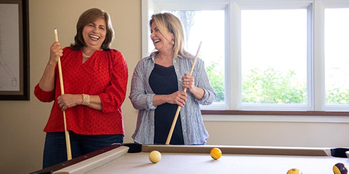Women playing pool